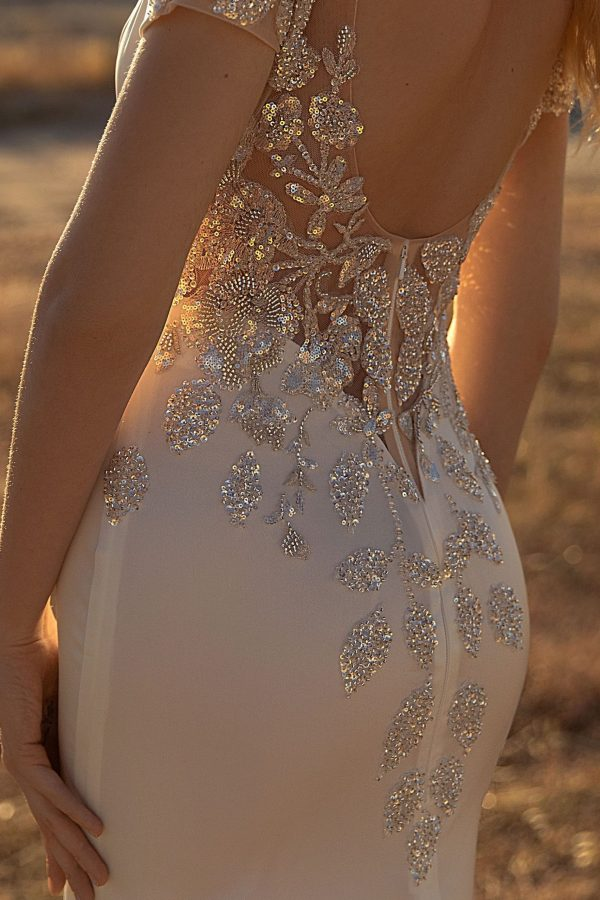 fitted low backed wedding dress